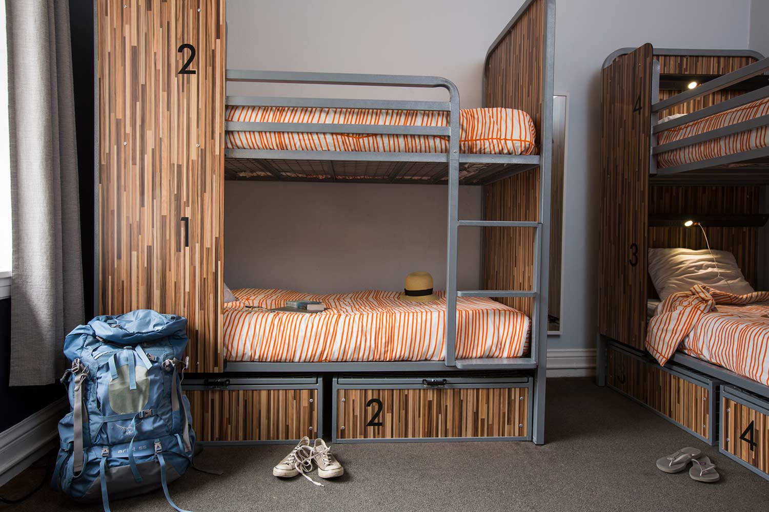 Room view with bunk beds, backpack, and shoes.