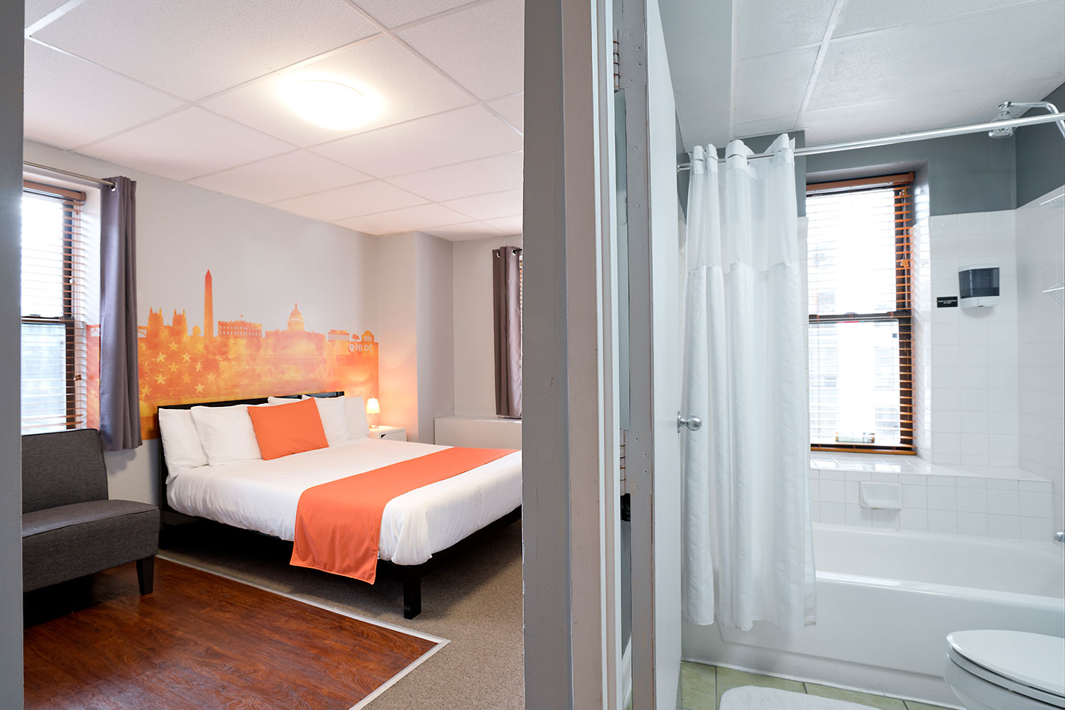 Room view with queen bed and private bathroom.