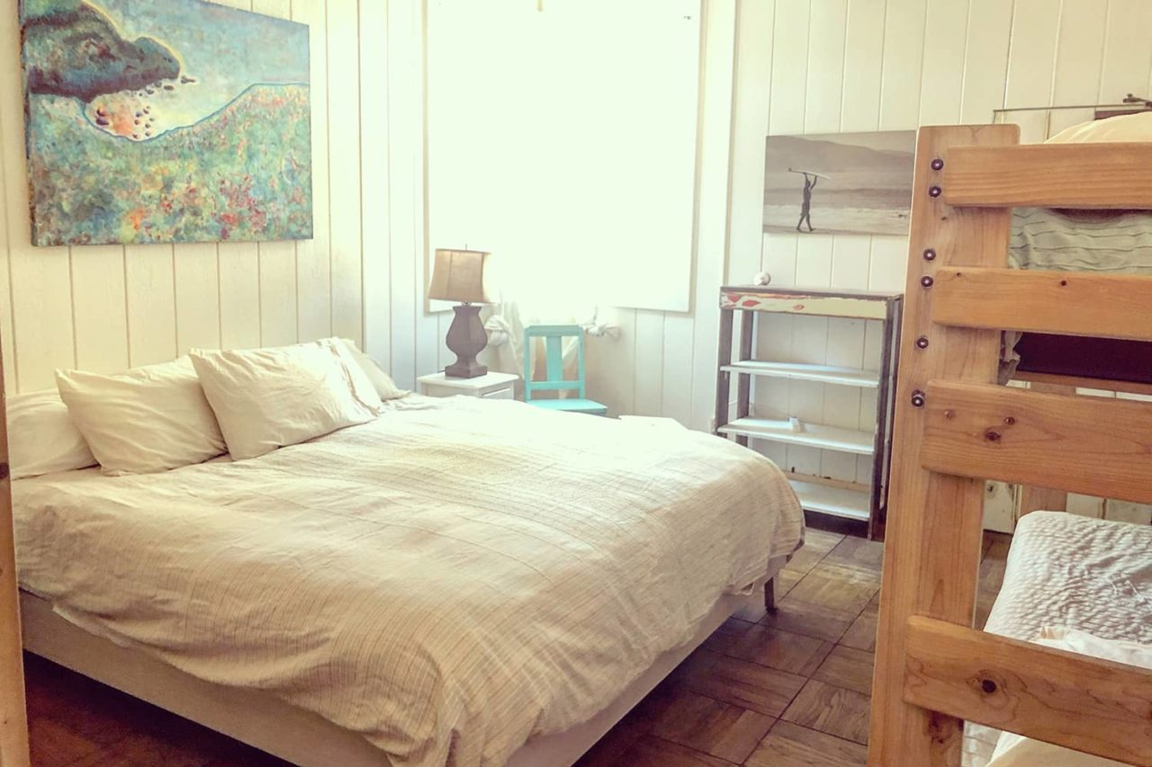 a bedroom in the historic lodge at HI Point Reyes