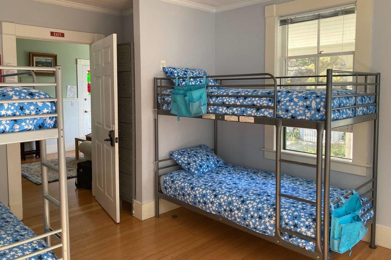 a bunk room at hi santa cruz hostel showing four beds