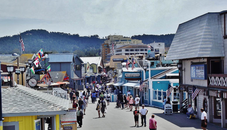 a crowd of people at fisherman's wharf in monterey