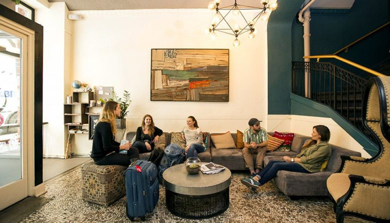 A group of people in a hostel lobby