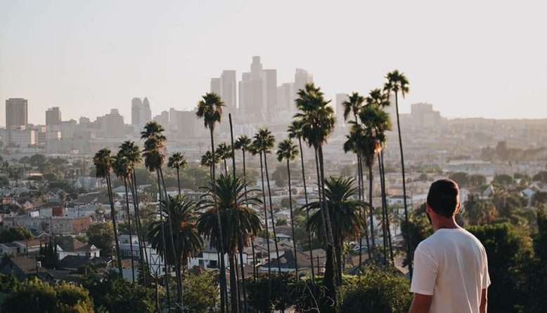 A man looking at Downtown Los Angeles