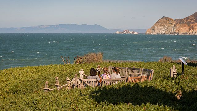3 women looking at the ocean at Point Montara Lighthouse