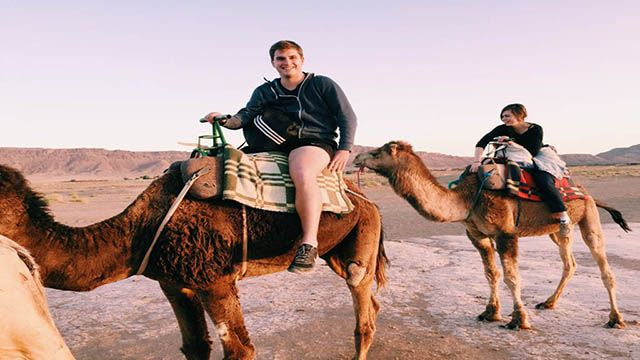a couple riding camels