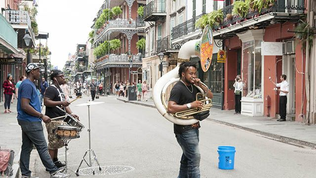 a band plays in New Orleans French Quarter