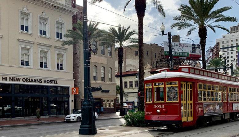 a streetcar passes HI New Orleans hostel