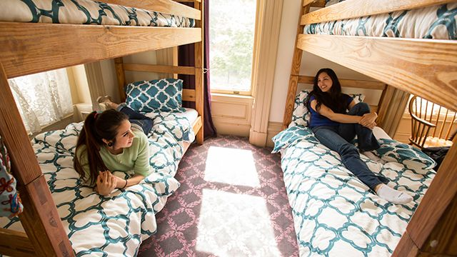 Two women in a dorm bed in a hostel