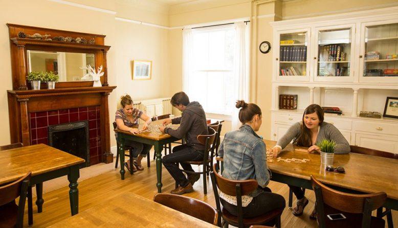 travelers playing board games at HI Marin Headlands hostel