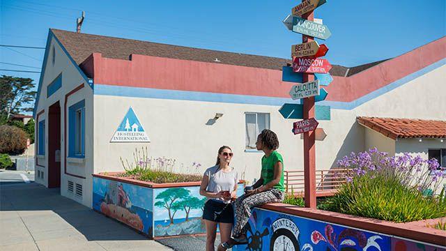 two women in front of HI Monterey hostel