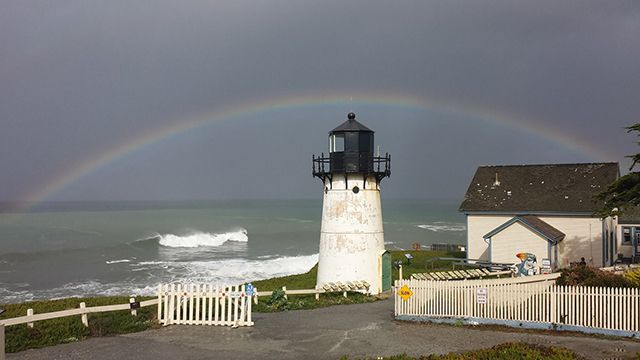 a rainbow over point montara lighthouse