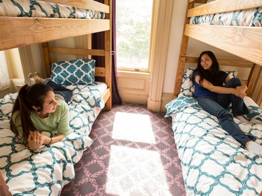 hostellers in a dorm room at HI Sacramento hostel