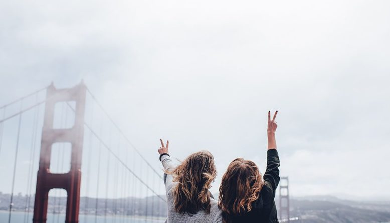 Two women standing at the Golden Gate Bridge