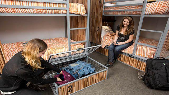 two women in a hostel dorm room