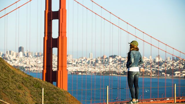 woman looking out over the golden gate bridge