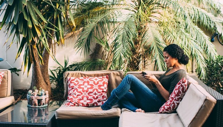 woman relaxing in a hostel back yard