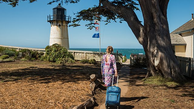 woman with a suitcase at Point Montara lighthouse hostel