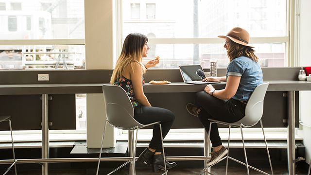 two women in front of a laptop at HI Chicago hostel