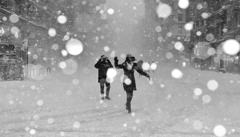 Two people dancing in the snow