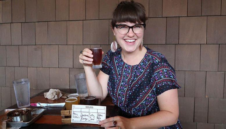 a woman tasting beers in Austin