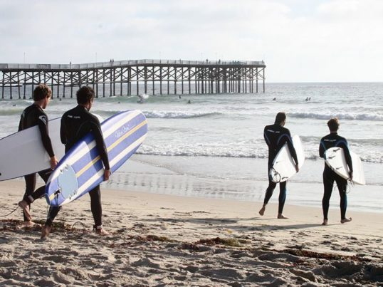 surfers at pacific beach in san diego