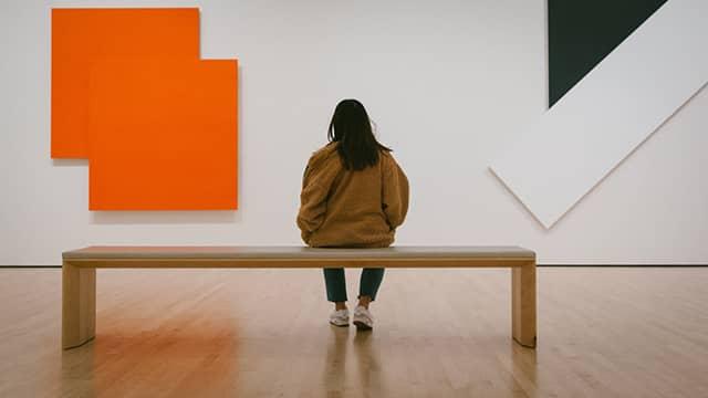 a museum visitor looking at artwork at SFMOMA