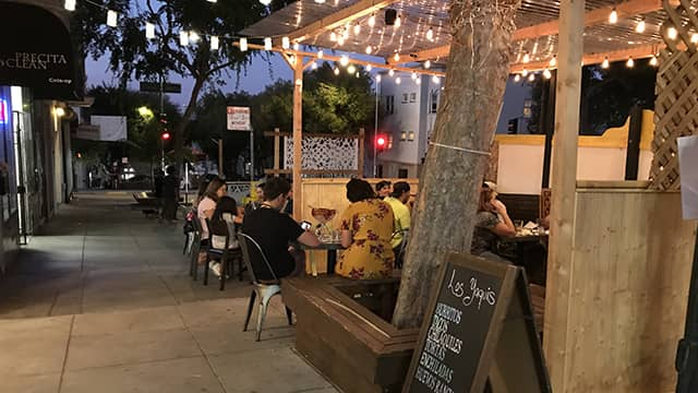 people eating on a pop-up patio in San Francisco