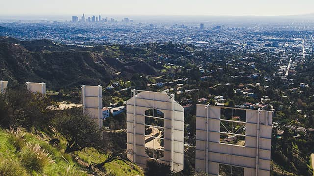 a view of LA from behind the Hollywood sign