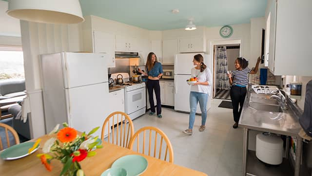 guests using the kitchen at HI Pigeon Point lighthouse