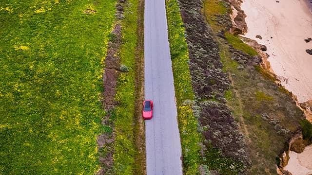 a car driving down coastal Hwy 1