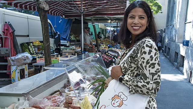 the author Jessica van Dop DeJesus shopping at an outdoor food market in Milan