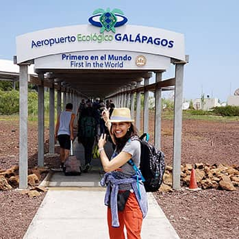 journalist Tinabeth Pina stands in front of the Airport in the Galapagos Islands